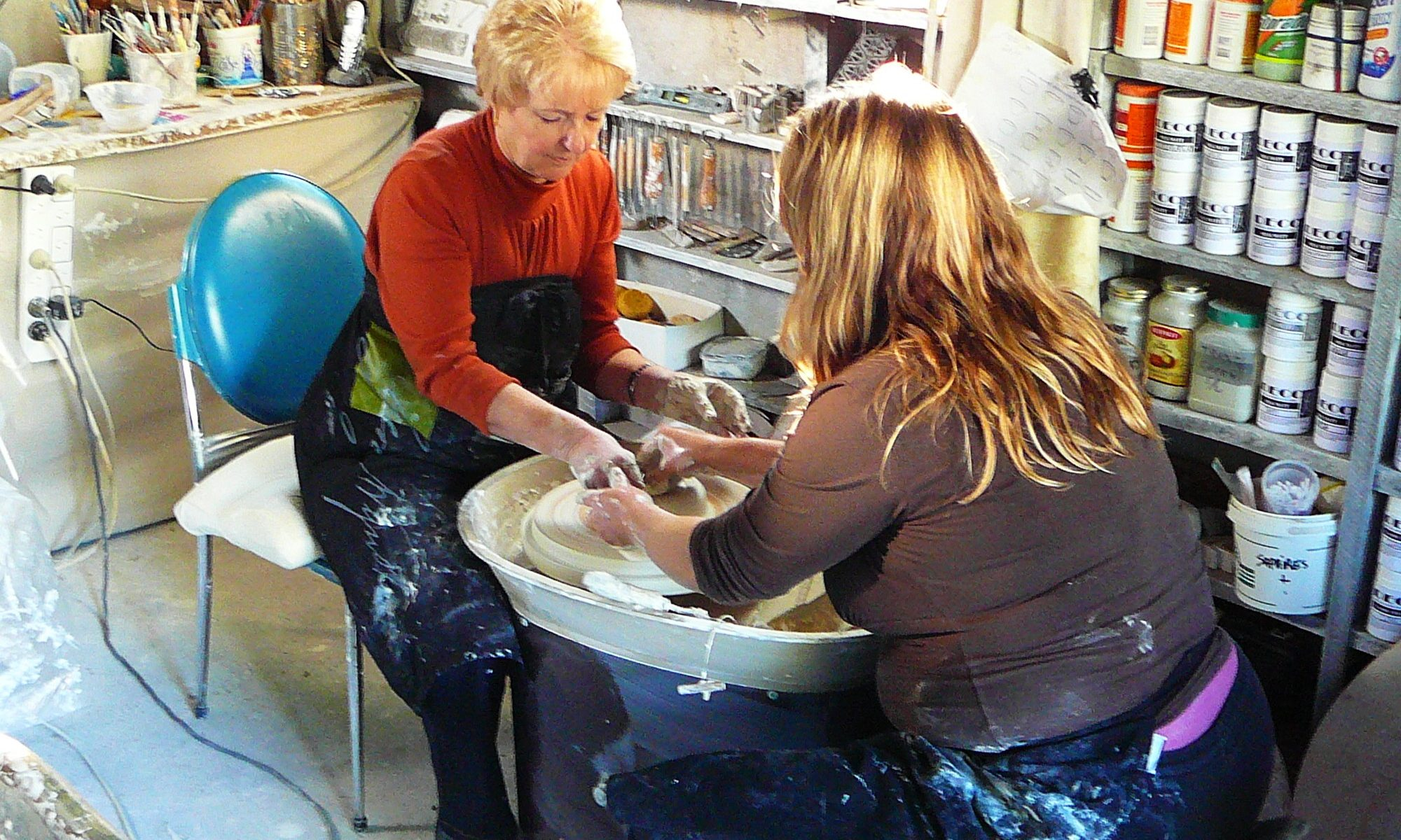 Pottery classes teacher and student