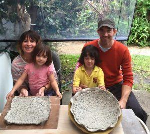 family pottery class smushing platter